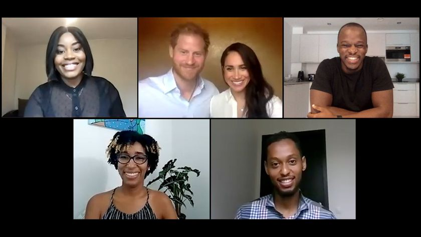Britain's Prince Harry and Meghan, Duchess of Sussex, speak with young leaders about equal rights
