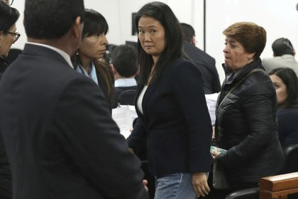 FILE - In this Oct. 24, 2018 file photo, Keiko Fujimori, the daughter of Peru's former President Alberto Fujimori, and leader of the opposition party, center, attends a hearing in Lima, Peru. A Peruvian prosecutor requested on Thursday, March 11, 2021, for 30 years in prison for Keiko Fujimori and the dissolution of her political party for allegedly laundering money from the Brazilian construction company Odebrecht. (AP Photo/Martin Mejia, File)