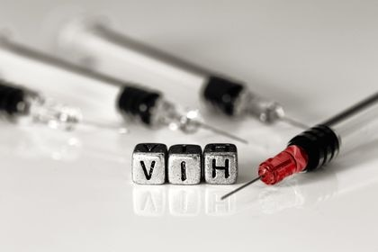 Syringes and blood with the word HIV on beads