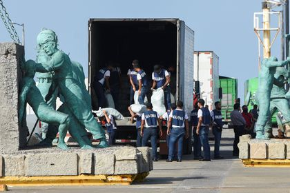 Mexican Navy personnel unload a truck with sacks of food and medicines to load it onto the ARM Papaloapan (A-411) ship as part of the Mexican government's aid for Cuba, at a dock in Veracruz, Mexico July 22, 2021. REUTERS/Yahir Ceballos