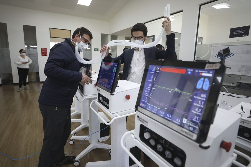 Engineers from La Sabana University demonstrate low-cost ventilators for patients with COVID-19 in Bogota, Colombia, Monday, July 6, 2020. The machine called the Heron looks like many other ventilators used to treat COVID-19 patients, but this device costs about $4,000, a fifth of the price of ventilators imported from China, and it's made in Colombia, where some hospitals have been overwhelmed by coronavirus patients. (AP Photo/Fernando Vergara)
