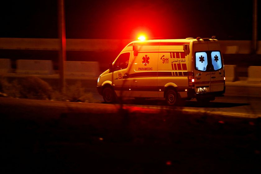 An ambulance heads towards the city of Zarqa on the highway between Amman and Zarqa