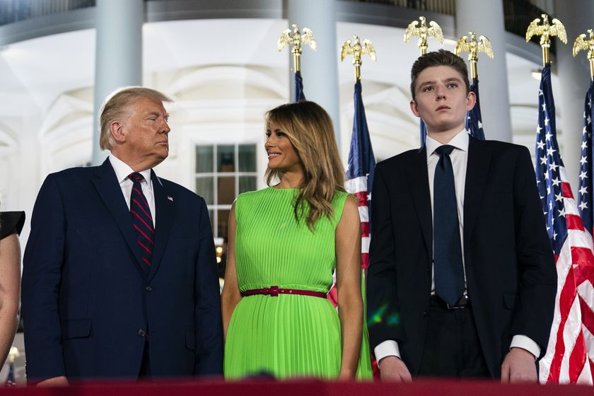 FILE - In this Aug. 27, 2020 file photo, Barron Trump right, stands with President Donald Trump and  first lady Melania Trump on the South Lawn of the White House on the fourth day of the Republican National Convention in Washington. (AP Photo/Evan Vucci)