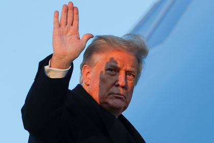 U.S. President Donald Trump waves as he boards Air Force One at Joint Base Andrews in Maryland, U.S., December 23, 2020. REUTERS/Tom Brenner     TPX IMAGES OF THE DAY
