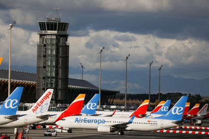 Iberia and Air Europa airplanes are parked at a tarmack at Adolfo Suarez Barajas airport amid the coronavirus disease (COVID-19) pandemic in Madrid.