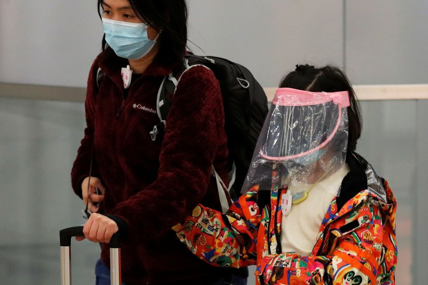 A child wears self made mask as she arrives at Hong Kong West Kowloon High Speed Train Station Terminus, before temporary closing, following the coronavirus outbreak in Hong Kong