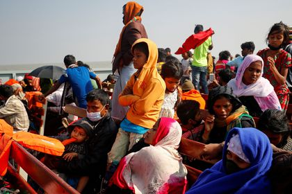 FILE PHOTO: Rohingya refugees sit on wooden benches of a navy vessel on their way to the Bhasan Char island in Noakhali district, Bangladesh, December 29, 2020. REUTERS/Mohammad Ponir Hossain/File Photo