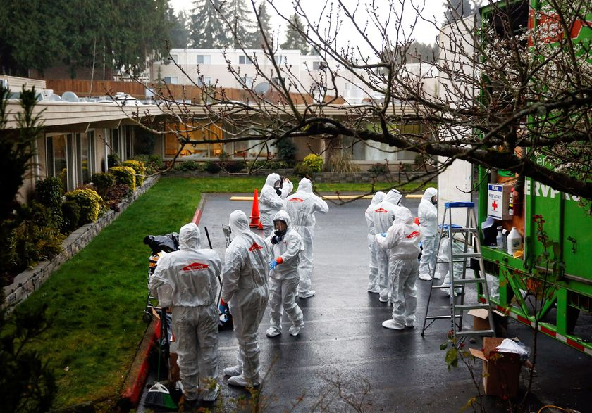 A Servpro cleaning crew puts on protective gear before entering Life Care Center of Kirkland