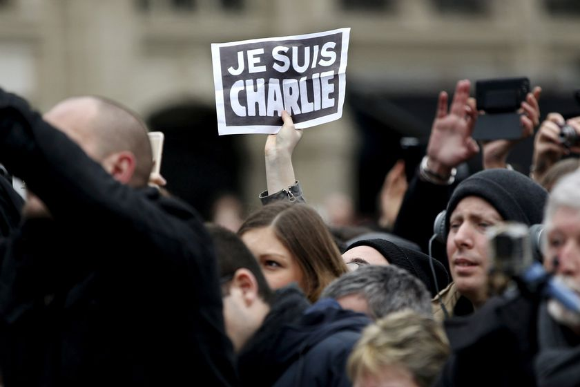 FILE PHOTO: Person holds up a sign during a ceremony at Place de la Republique square to pay tribute to the victims of last year's shooting at the French satirical newspaper Charlie Hebdo, in Paris