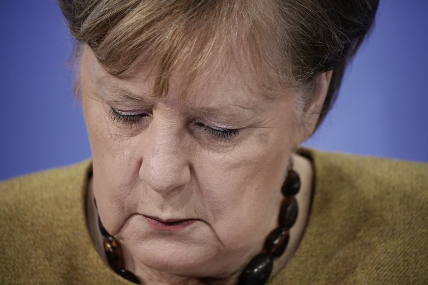 Germany's Chancellor Angela Merkel takes part in a press conference following the consultations between the federal and state governments on further COVID measures, in Berlin, Tuesday, Jan. 5, 2021. (Michael Kappeler/pool photo via AP)