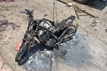 Burned motorcycle is pictured in the aftermath of an explosion in Jolo Island