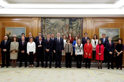 Spain's King Felipe VI poses with Prime Minister Pedro Sanchez and members of cabinet at Zarzuela Palace in Madrid