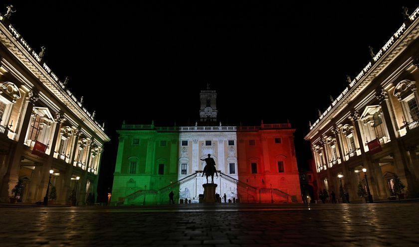 FILE PHOTO: Rome's Town Hall is lit up with the colours of the Italian flag to show solidarity with the country as it continues to battle coronavirus, in Rome