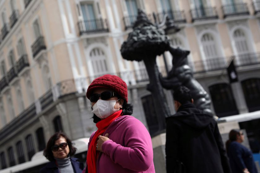 A tourist wears a protective mask outside Puerta del Sol square amid the novel coronavirus outbreak in Madrid