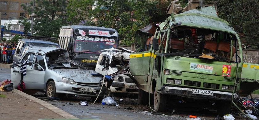A mini bus and passenger cars pilled up after the explosion in Nairobi, Kenya, Saturday, Dec. 14, 2013. Several people are feared dead and others injured in an explosion on a minibus in Nairobi's Pangani residential estate, the Kenyan police said on Saturday. (AP Photo) .