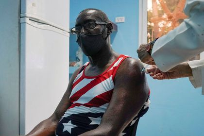 FILE PHOTO: A man is vaccinated at a vaccination center amid concerns about the spread of the coronavirus disease (COVID-19) in Havana, Cuba, June 17, 2021. REUTERS/Alexandre Meneghini/File Photo