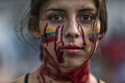 "A student performs a play called ""Who killed them"" during anti-government protests in Cali, Colombia, Tuesday, May 11, 2021. Colombians have protested across the country against a government they feel has long ignored their needs, allowed corruption to run rampant and is so out of touch that it proposed tax increases during the coronavirus pandemic. (AP Photo/Andres Gonzalez)"