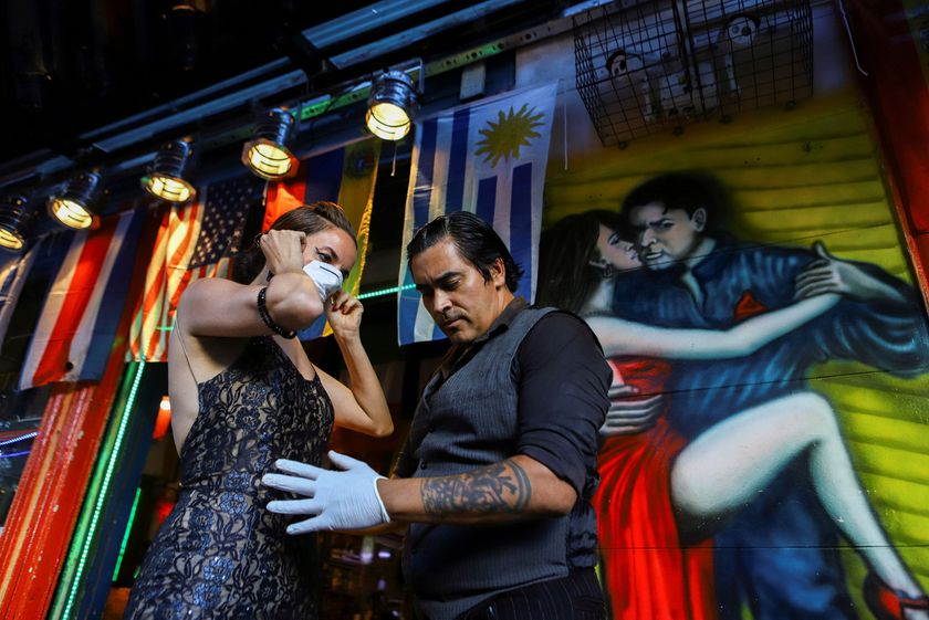 "Makrina Anastasiadou puts on a face mask before dancing with her tango partner ""El Morocho"" after tango shows have been suspended to prevent the spread of coronavirus (COVID-19), in Buenos Aires"