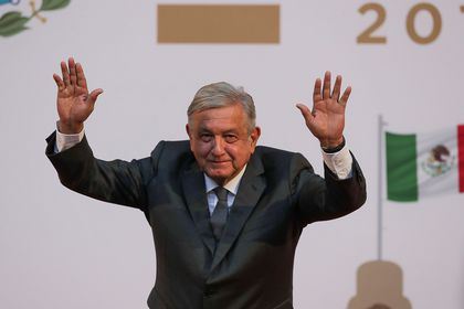 Mexico's President Andres Manuel Lopez Obrador waves after addressing to the nation on his second anniversary as the President of Mexico, at the National Palace in Mexico City, Mexico, December 1, 2020. REUTERS/Henry Romero