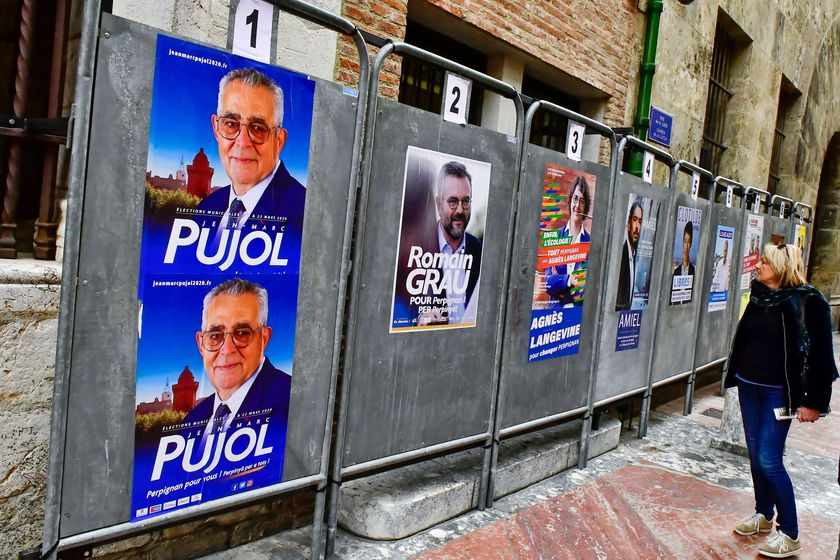 Campaign posters of Jean-Marc Pujol, Mayor of Perpignan, are seen in front of the city hall in Perpignan